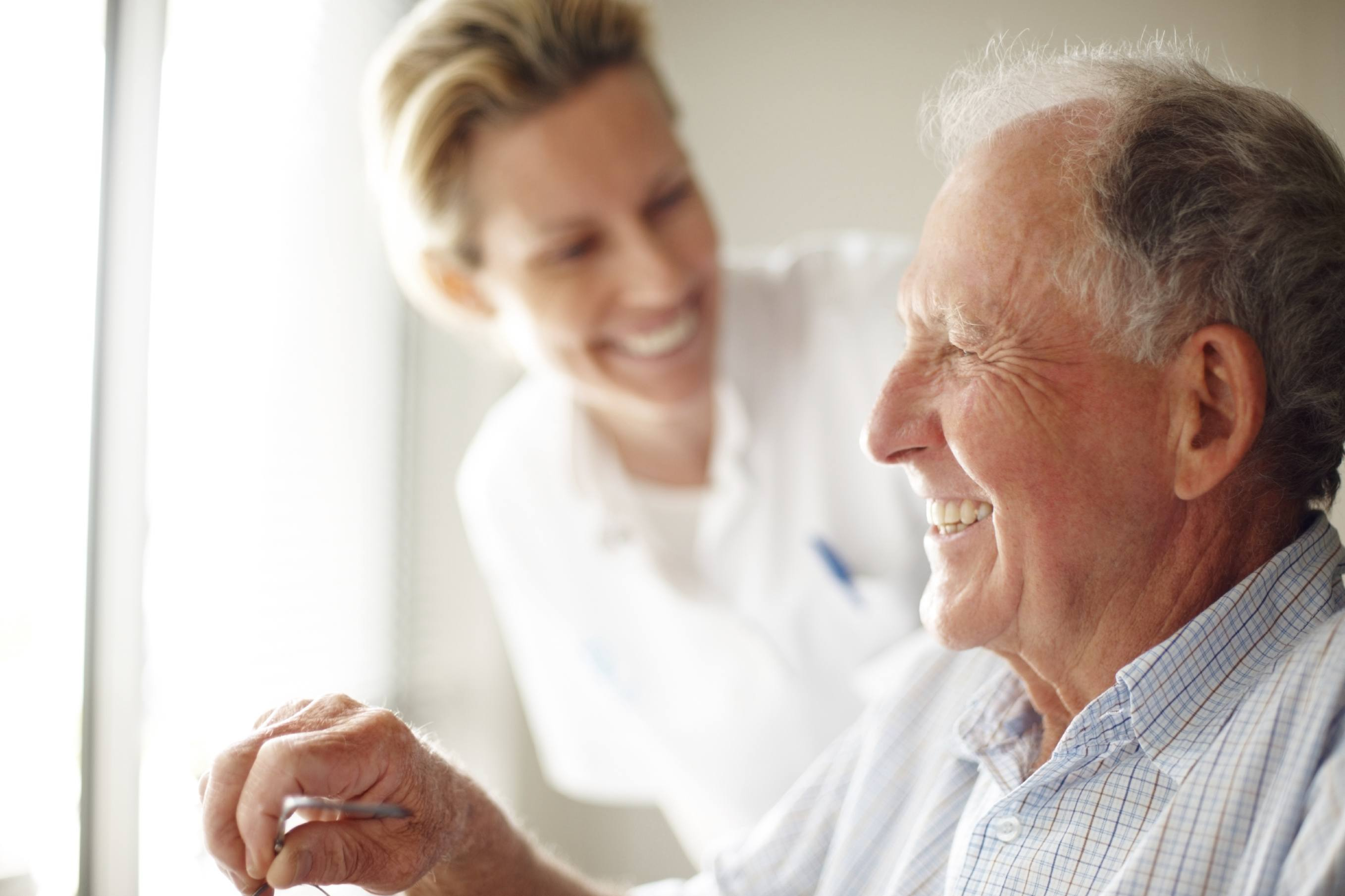 Nurse laughing with senior